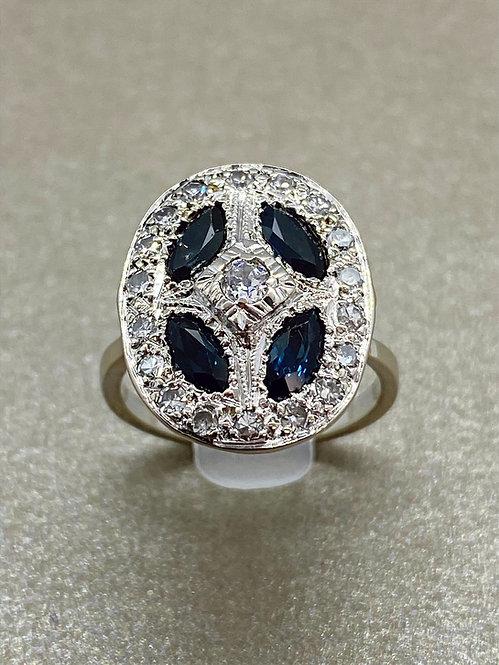 Bague Art Déco en or saphirs navette et diamants