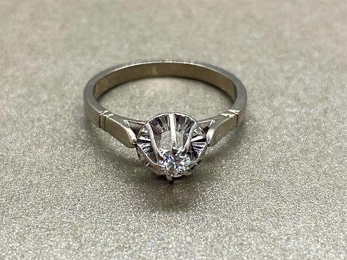 Bague solitaire en or gris, platine et diamant