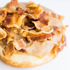 Bacon on a donut_ Sure, why not_! Pancakes with maple syrup and a side of bacon is such a staple of American breakfast! On a donut- it's eve
