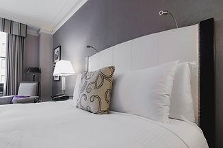 bright-hotel-room-bed.jpg