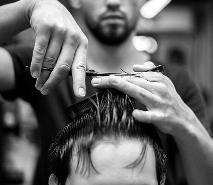 wet-hair-getting-haircut-barber-shop_23-