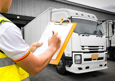 warehouse-worker-hand-holding-clipboard-