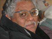 Elderly Man Wears New Glasses