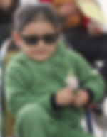 Young Boy showing off his new sunglasses