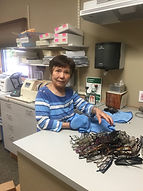 Palace City Lions Club Member cleans glasses at Avera optometry in Mitchell, SD