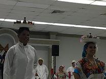 dancers balancing beer on their head