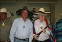 Dr. Thomas Garrity and friends pose with hats, fake guns, etc.