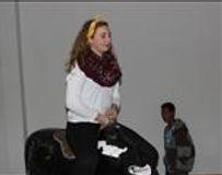 Emily rides a fake bull