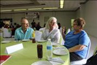 Kay Thomas and some friends wait for lunch to start