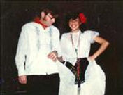Dr. Tom Garrity and his friend dance in fancy clothes
