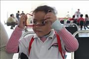 Girl puts on glasses for first time