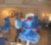 Mexican Dancers in cowboy hats and fancy dresses