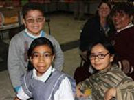 Smiling Mexican children with glasses take photo