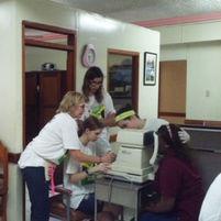 Four volunteers take autorefractor