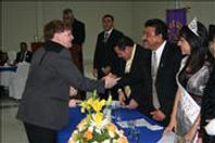 Dr. Thomas Garrity shakes hands with Gomez Palacio Lions Club President during a awards ceremony