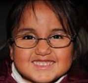 Mexican girl with glasses smiles big
