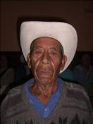 Elderly Mexican Man with cataracts wears cowboy hat