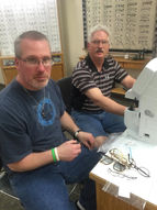 Palace City Lions Club members verifying glasses