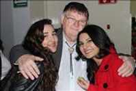 Dr. Tom Garrity gets hugs from two beautiful Mexican girls
