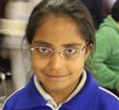 Girl with glasses shyly smiles