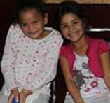 Two excited girls wait for their eyes to be examined