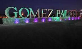 Gomez Palacio sign lit up at night