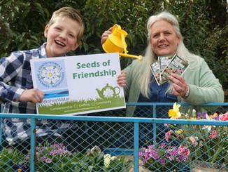 Angela Kay and son Ferdie delivering seeds.jpg
