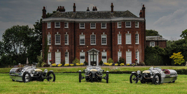 3 Pembleton V-Sports outside an English country house