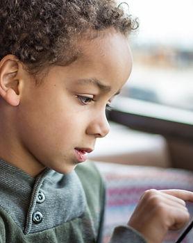 Boy Reading Tablet