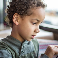 A Boy Reading on Tablet