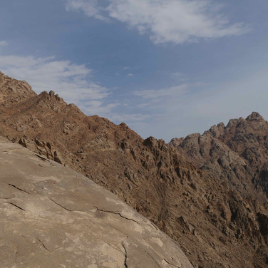 The trail continues steeply into the mountains, traversing high & sometimes exposed ledges towards a rugged ridgeline.