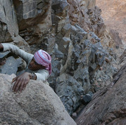 Jebel Um Samyook is a 1535m-high peak in the wild, westerly parts of the Jebel Abul Hassan range. Steep rocky gullies have to be climbed in its lower parts.