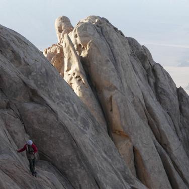 Smooth, sloping slabs of granite must be traversed between the summits.