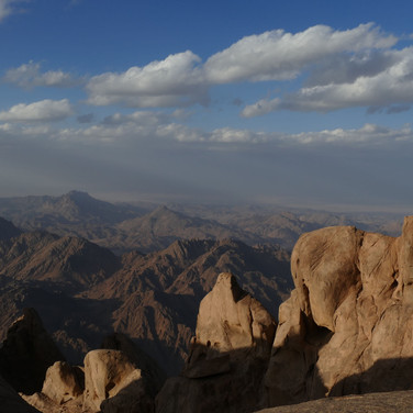 Gazing north from Jebel Shayib's summit, in the late afternoon light. The wide open spaces of the coastal plain are seen in the distance.