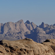 Looking back to the south: the jagged summits of Jebel Abul Hassan rise faraway on the horizon.