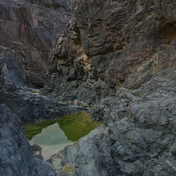 The Emerald Pools of Jebel Abu Dukhaan. The Bedouin call pools like this a 'kharaza' meaning the 'bead' of a necklace. A 'kharaza' is a pool left by rain & dries out in hotter times.