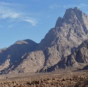Mohammed leads the way below the northerly peaks of Jebel Gattar. Can you see him ahead?