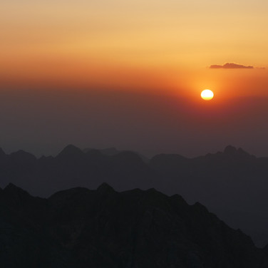 The sun sets for the last time on the RSMT thru hike, moving down towards the rugged highlands of Jebel Abul Hassan.