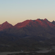 Looking back at the high ridgeline of Jebel Um Anab, glowing red in the last of the sun.