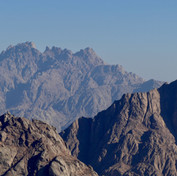 Jebel Shayib towers high on the horizon: hikers spend the last night of the hike on its summit.