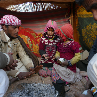 We wake up below Jebel Abu Dukhaan, as guests of a Bedouin family. Two young girls & budding shepherdesses sit next to RSMT head guide Mohammed Muteer at the fireside.
