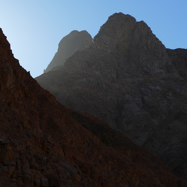 Towering high in the dawn: the pinnacles of Jebel Abul Hassan catching the first rays of the sun.
