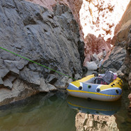 Ship of the Desert: ferrying bags over a deep pool.