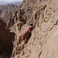 Jebel Shayib has several tricky sections, including this narrow ledge of loose, crumbling rock, all of which must be passed on the way to the top.