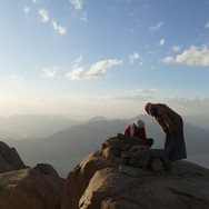 A small cairn marks Jebel Shayib's summit today. A biscuit tin is buried inside it, with pens, pencils & notebooks for hikers to record their names. The first recorded ascent of Jebel Shayib was made by Bedouin of the Ababda tribe & Scotsman George W Murray in the first half of the 20th century. British schoolteacher & writer Leo Tregenza, guided by Maaza Bedouin, reached the top in the following decades. One legend has it a Bedouin woman called Selima was the first person to ever climb Jebel Shayib, standing on top & gazing out to the faraway tablelands of the Nile Valley.