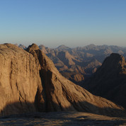 Jebel Gattar's beautiful summits turn amber as the sun lowers in the late afternoon.