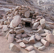 Ancient traps are found in Jebel Gattar. Traps like this are scattered widely across Egypt's deserts - especially the Sinai - where the Bedouin once used them to catch leopards. A live goat kid would be put inside with a string tied from its leg to a stone over the doorway. As the leopard entered the kid would instinctively run, jerking the stone down to trap it inside. The Bedouin of the Red Sea Mountains call these traps 'Nosrit el Theeb' meaning 'The Wolf Trap'. Some say they are of prehistoric origin & it's possible they were adapted to catch different animals between different eras as the climate & ecosystem changed.