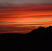 Under the red sky: sunset on the Plain of Monfia.