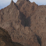 As the trail continues down through winding wadis the high pinnacles of Jebel Shayib - Egypt's highest mountain - emerge on the right. Jebel Shayib means the Old Man's Mountain & is named after the white tinted granite of its summit, which resembles the silvery hair of an old man.
