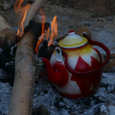 A pot of tea sits waiting on the fire at the meeting place in Wadi Abu Eren.